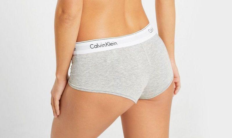 Rear view of women wearing grey Calvin Klein boy shorts