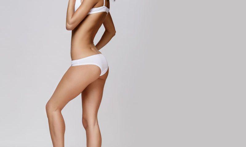 Women modelling white Brazilian knickers